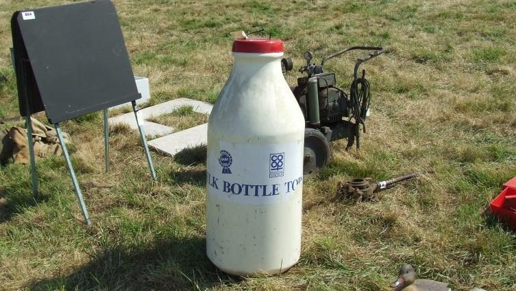 £75 - Lot 863: Large Milk Bottle