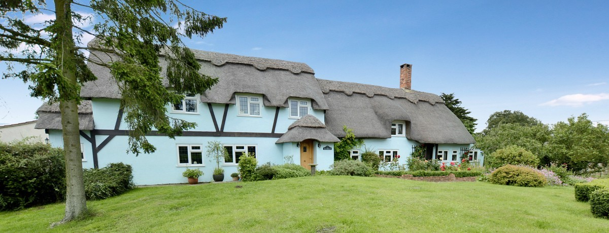 A delightful thatch cottage!  Bluebells Roughton at £465,000.